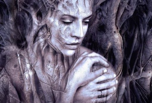 transparent woman overlayed with tree roots